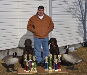 Joe and his champion dogs.