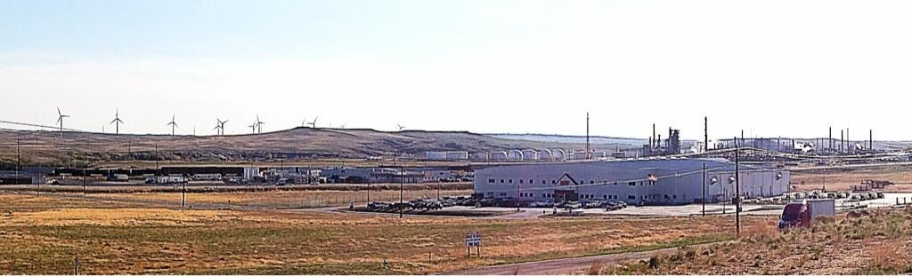 Wind turbines, coal rail car, and an oil refinery in Casper, WY.