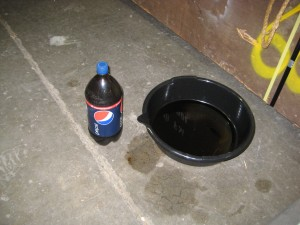 Used oil in a Pepsi bottle. Don't put it back in the fridge.